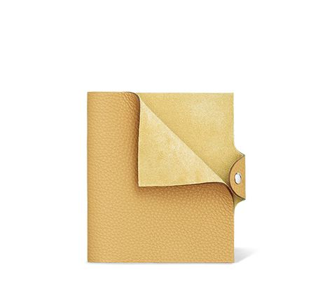 """Hermès Ulysse leather notebook cover in chick yellow 5.3"""" x 6.3"""" Leather tab with silver and palladium snap closure, Togo calfskin Ref. H036986CK1Z"""