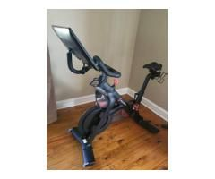 A Stationary Peloton Bicycle Is Available For Sale All Included