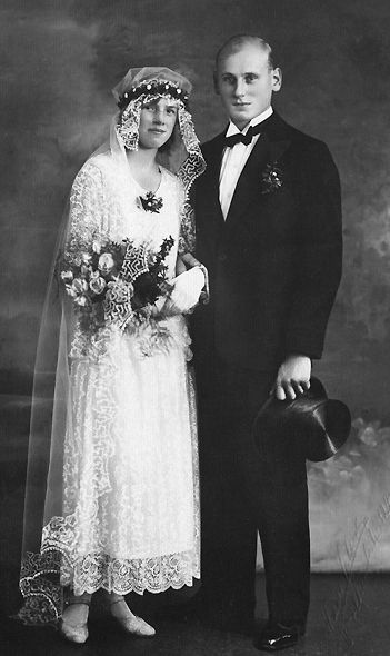 Vintage bride and groom...love the details in her dress and veil and