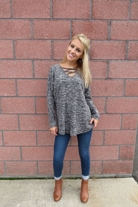 - the coziest & softest long sleeve top! - crisscross detail in the front & back make the cutest touch. you will want to wear this top ALL season long! - can pair with jeans, yogas or joggers! - model is 5'4, size 0/1, wearing a small, runs true to size!