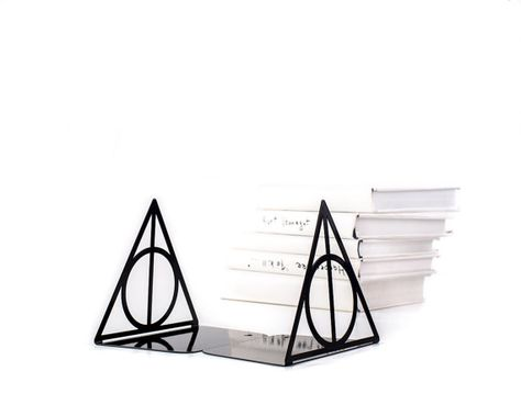 A pair of metal bookends Deathly Hallows Harry Potter Inspired. A perfect set for perfect books. Please your inner Potter fan. Use these