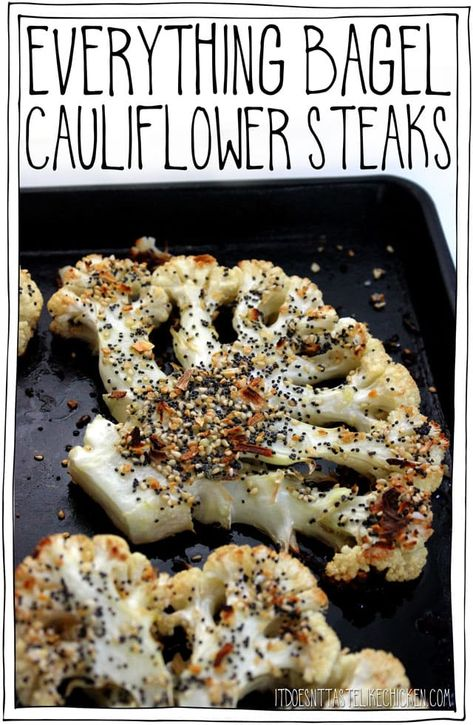 These Everything Bagel Cauliflower Steaks are tender, juicy, a little crisp around the edges, and the everything seasoning is toasted in the oven making this cauliflower irresistible! I could NOT stop eating these!Just 25 minutes to make. #itdoesnttastelikechicken #cauliflower #veganrecipes #everythingbagel