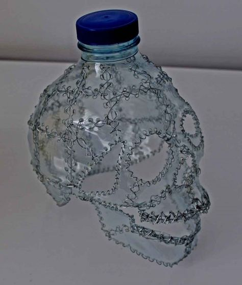 Skulls recycling in plastics art with Upcycled Recycled Plastic Bottle Art Made from recycled plastic bottles.