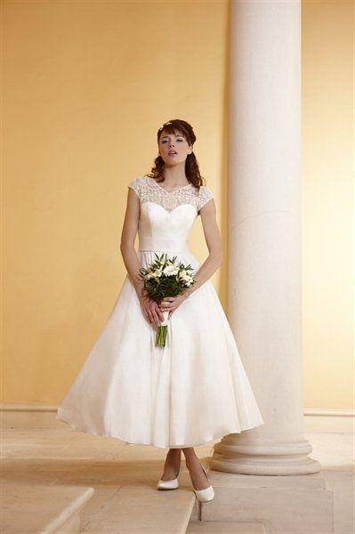 Phil Collins Bridal PC 1901.  I love the intricate neckline, and overall softness of this dress. Very much vintage inspired <3