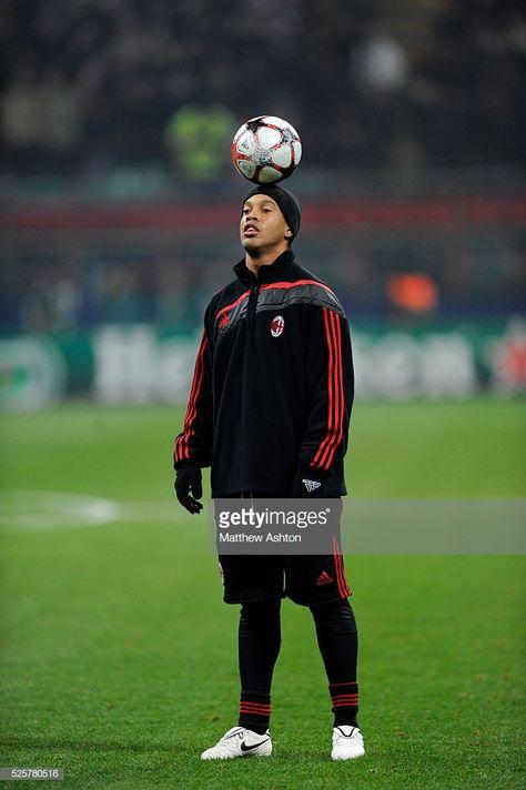 Ronaldinho of AC Milan balances a ball upon his head