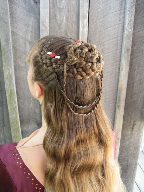 two dutch five strand braids with rope braids as accents.