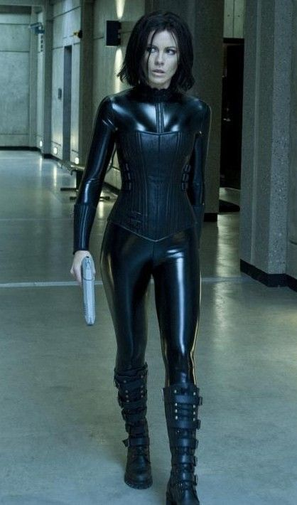 Selene from Underworld. I did this last year for Halloween. I'll probably wear this again but maybe drop the money for the contact lenses this year, buy a wig ( black hair spray paint doesn't work well on blonde hair) and will need to replace my toy gun.
