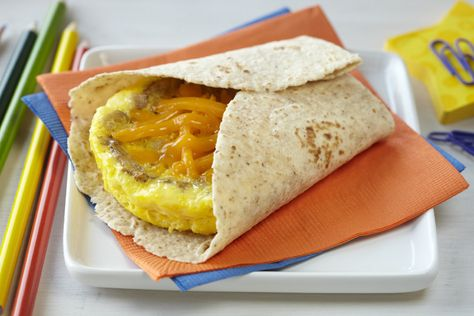 Microwave #EGG, Sausage & Cheddar Breakfast Tortilla | Give scrambled eggs a kick with spicy sausage and creamy cheese. A perfect on-the-go breakfast burrito! IncredibleEgg.org/Recipes
