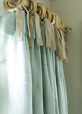 A cute way to hang curtains - just sew on ribbons and tie them to the rings. Untie to take down and clean.