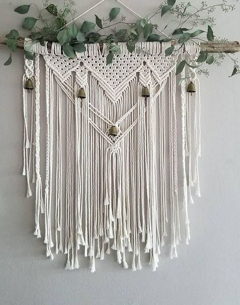 Whether you're drawn to rustic elegance or bohemian tapestry; this macramé wall hanging will add the perfect touch of texture and charm to any living space. Created from driftwood, cotton rope and antique-finish brass bells. This item is made to order and will vary slightly from the photos