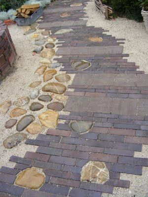 Brick Paver Path with rocks edged in gravel.  Gives off a nice beach vibe.