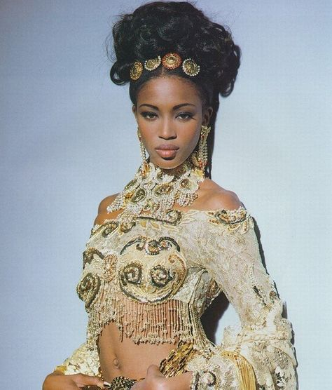 cultofmaia: A young Naomi Campbell wearing Gianni Versace. Gold lace, sequins and rhinestones, Gianni Versace was the king of over the top. Merging fantasy and reality, some may even say tacky but I love him!