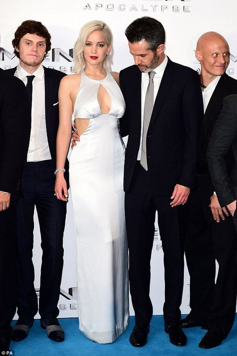 Turning heads: Jennifer also seemed to distract director Simon Kinberg (right)