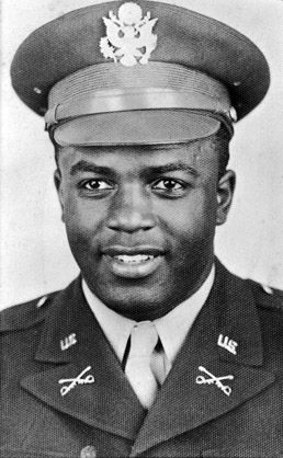 In 1942, Jackie Robinson was drafted into a segregated Army unit. He served with boxing legend Joe Louis.