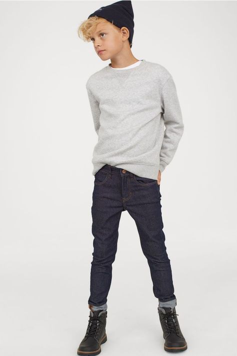 Slim-fit jeans in washed stretch denim with front and back pockets.