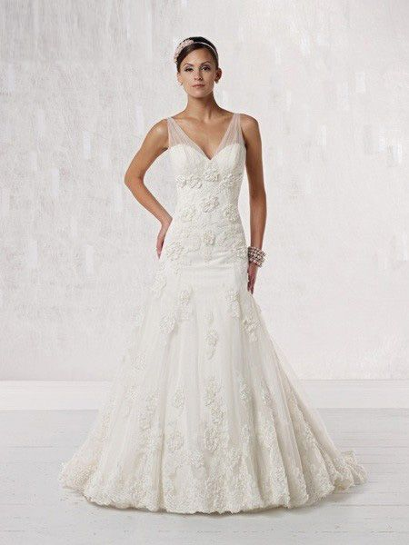 Stunning Halter Wedding Dress With Assymmetrical Styling To Create A Slimming Look Draped Details