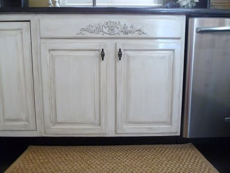 How to create distressed kitchen cabinets.