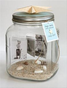 Sand, shells, etc. in the bottom. Attach photos to strings to lid... first (or any) beach visit keepsake!