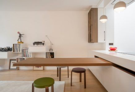 The Dining Table Is Cleverly Hidden In The Countertop Of This Chic