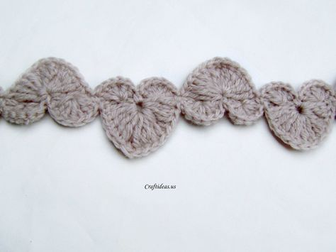 Valentine craft:  String of hearts -- scarf, garland, bracelet, or necklace.  Free crochet pattern