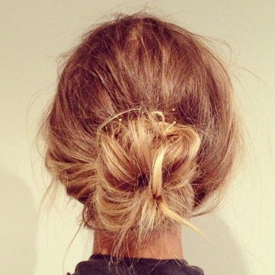 messy bun {this hairstyle is the easiest way to get your hair off your face and neck, and it looks cute too.}