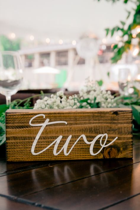 Wood block table number for a rustic wedding | Photo: Amy Rizzuto | NJ wedding venue: Bear Brook Valley