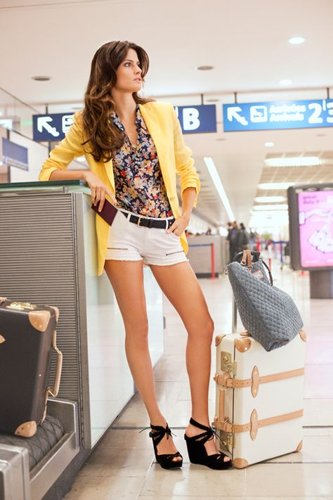 Turn heads at baggage claim with white cut-offs and a bright blazer.