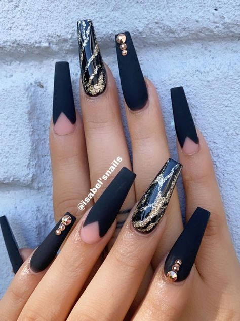 Amazing matte black coffin nails with an accent shiny black nail with gold glitter!