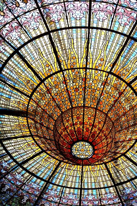 Fabulous Art Nouveau stained glass ceiling of the Palau de la Música Catalana, Barcelona, Spain.  Photographer unknown.  The Palace of Catalan Music is a UNESCO World Heritage site.