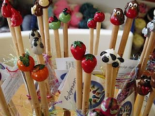 Whimsical hand crafted knitting needles!  Various designs and sizes. 2013 Faire