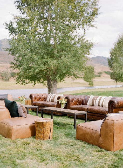 Consider mixing neutral and earth tones with wooden accents for a look that feels cohesive, no matter your wedding style. This furniture is the perfect area for guests to mingle during your cocktail hour and reception. Click through to see more barn wedding inspiration! #barnwedding #weddingfurniture #weddingrentals #weddingdecorideas #cocktailhour #rusticweddingdecor