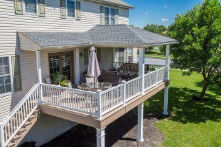This Porch Includes Both A Covered And Uncovered Areas Perfect For Enjoying Both Sun And Shade A Hip Roof Protects Porch Design Building A Deck Deck Addition