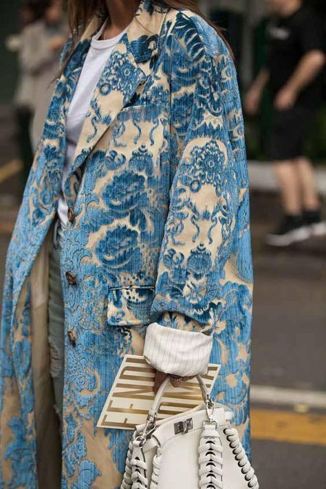A beautifully embroidered Miu Miu coat snapped at the 2017 Milan Fashion Week.