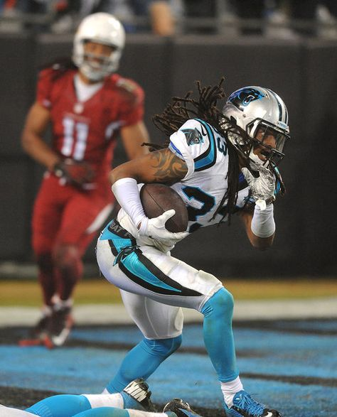 Carolina Panthers safety Tre Boston (33) intercepts a pass by Arizona Cardinals quarterback Ryan Lindley (14) during fourth quarter action on Saturday, January 3, 2015 in Charlotte, NC. The Panthers defeated the Cardinals 27-16 in NFL Wild Card action.