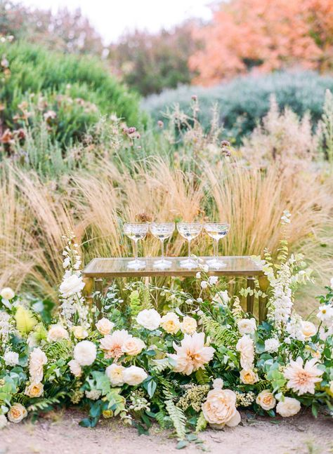 Inspired by a gray wedding dress with flutter sleeves and intricate beading, this gorgeous wedding styled shoot in California features pastel hues with a ceremony under a massive oak tree. We are loving this al fresco California wedding perfect for every season!