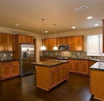 Image Result For Wood Flooring That Looks Good With Golden Oak Cabinets Cherry Wood Cabinets Wood Kitchen Cabinets Oak Kitchen Cabinets