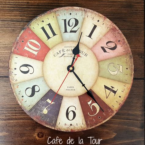 Get that rustic European look with this colorful French Country style wood wall clock. This delightful timepiece is a smart addition to your rustic, vintage, shabby chic or even modern decor. Runs on