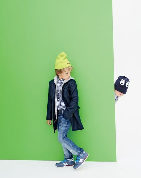 NOV Style Guide: J.Crew boys' topcoat, summit fleece hoodie, Ludlow shirt, slim destroyed jean in beat-up wash, kids' reversible superhero beanie and New Balance® for crewcuts glow-in-the-dark 410 sneakers.
