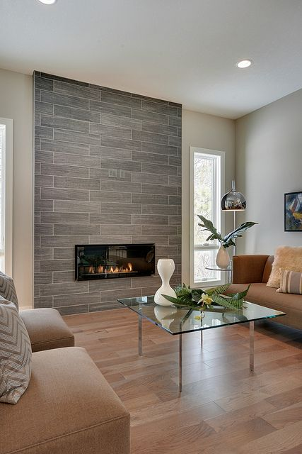 beautiful tiled fireplace in the living room.