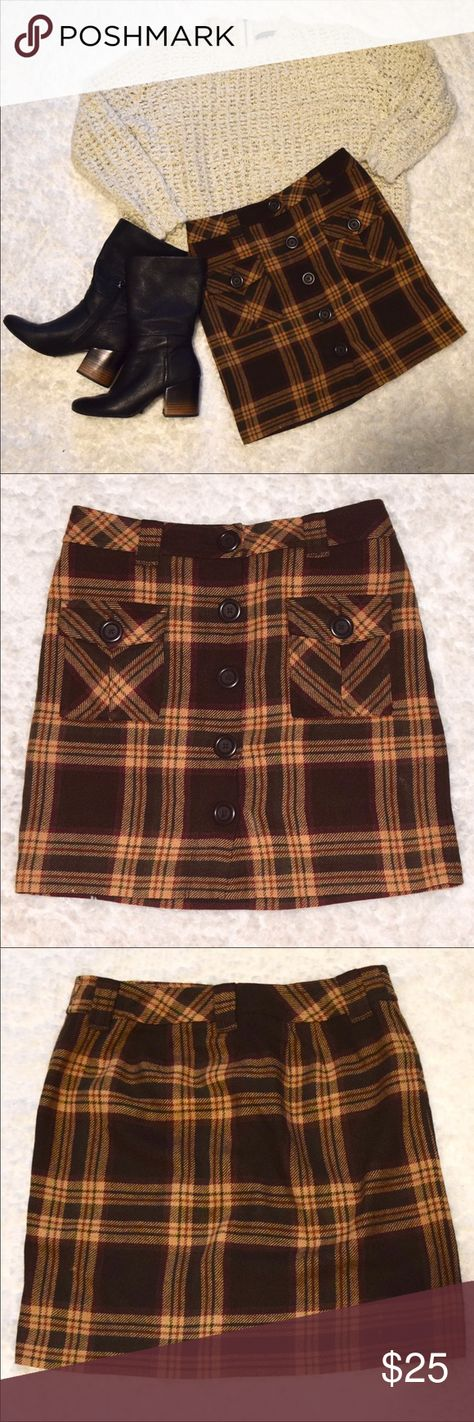 Ann Taylor 4P Wool Plaid Skirt with Pockets Size 4 Petite   Shell:  48% Acrylic  20% Cotton 16% Polyester 14% Wool 2% Nylon  Lining: 100% Acetate  Excellent condition.   Real pockets and belt loop! Five buttons down.   Perfect fall or winter pattern and material.   Would look great with: tights, high boots, crop sweater. Tights, high boots, bodysuit & cardigan. Long sleeve crop top with tights and boots, endless possibilities. LOFT Skirts