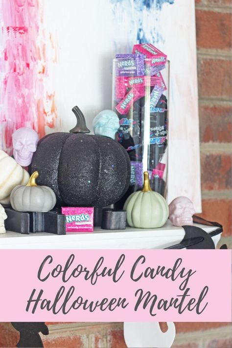 This colorful candy Halloween mantel was inspired by Nerds and SweetTarts. It combines the fun candy colors with a few black and white pieces for a festive mantel. Best of all, it can later be handed out to trick or treaters or enjoyed by you!