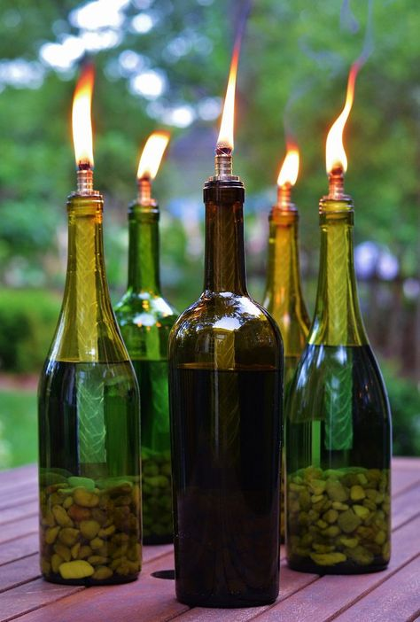 DIY Outdoor Decor to Keep Bugs Away wine bottle tiki torches<br> Mosquitoes, gnats and other bugs are a disruption to outdoor entertaining. Keep bugs away from your outdoor party with these DIY outdoor décor ideas. Recycled Wine Bottles, Lighted Wine Bottles, Bottle Lights, Wine Bottle Candles, Wine Bottle Lighting, Wine Bottles Decor, Reuse Wine Bottles, Decorating Wine Bottles, Wine Bottle Chandelier