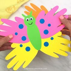 This handprint butterfly craft is great for toddlers, preschool kids and for kindergarten. It's an easy DIY art project for kids to make for Mother's Day or when learning about bugs and insects!   #handprintcrafts #simpleeverydaymom #butterflycrafts #preschool #kindergarten #toddlers #teachingkindergarten #preschoolers #mothersday #insectcrafts #kidscrafts #craftsforkids #kidsandparenting #ideasforkids #easykidscrafts #handprintart #preschoolactivities #springcrafts #summercrafts
