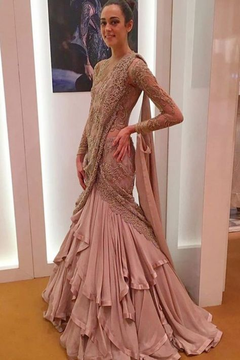 Dusty Pink silk ready to wear lehenga with net choli. This lehenga choli is embellished with embroidered . It is perfect for Party Wear