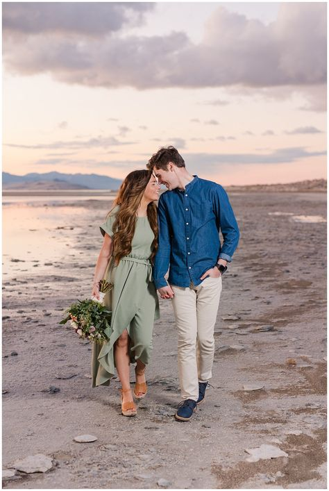 Couple dressed up for Antelope Island Engagement with bouquet | Antelope Island Engagements | Utah Wedding Photographers | Jessie and Dallin Photography  #utahwedding #utahengagement #engagementphotography #engagmentsession #engagementphotos #uniqueengagement #weddingflorals #beachengagment #engagmentsunset #couplesphotography #brideandgroom #romanticengagement #elegantengagement #utahweddingphotographer