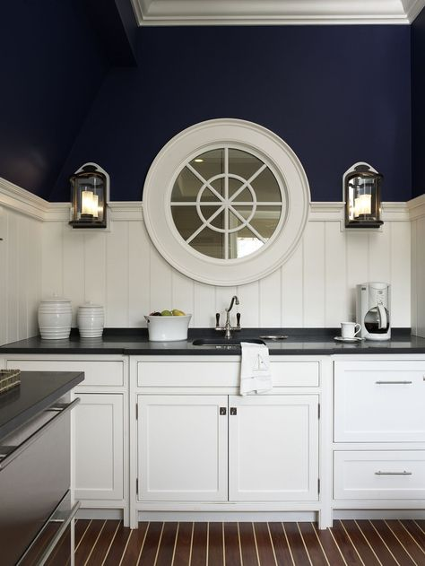 dark cabinetry and white shelving