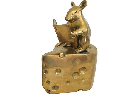 brass mouse on cheese reading
