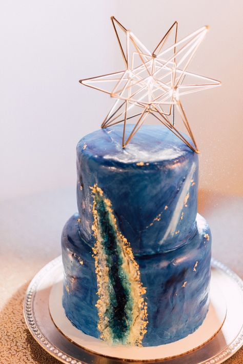 A galaxy themed industrial navy and gold wedding inspiration shoot with geometric details.