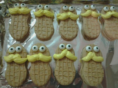 """The Lorax cookies, Dr. Seuss. Nutter Butters with candy eyes (craft aisle.) Colored vanilla frosting yellow and used a disposable piping bag (craft aisle) with a """"star"""" decorating tip; made one pass on each from left to right. Used a toothpick to apply a bit of frosting to the back of the eyes."""