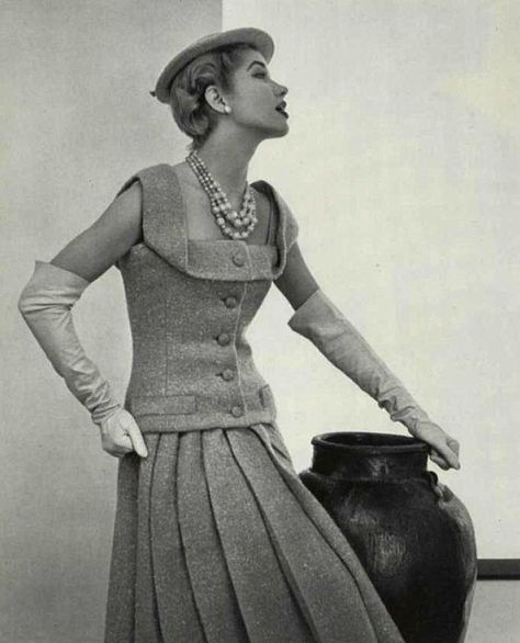 1955 Christian Dior--The top would make a great vest, i like the collar turn.